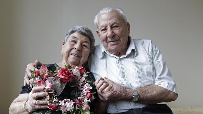 Maddalena, 88, and Fortunato Corso, 89, a Bensonhurst couple married 72 years who met in Calabria, Italy, and married on Feb. 4, 1941, pose for a photograph at their home in New York, Wednesday, Feb. 13, 2013.  On Thursday they'll be honored by Brooklyn borough President Marty Markowitz in a celebration of couples married 50 years or more.  The Corso's, who met as teenagers in Calabria, Italy, and married Feb. 4, 1941, have seven children, three girls and four boys. (AP Photo/Kathy Willens)