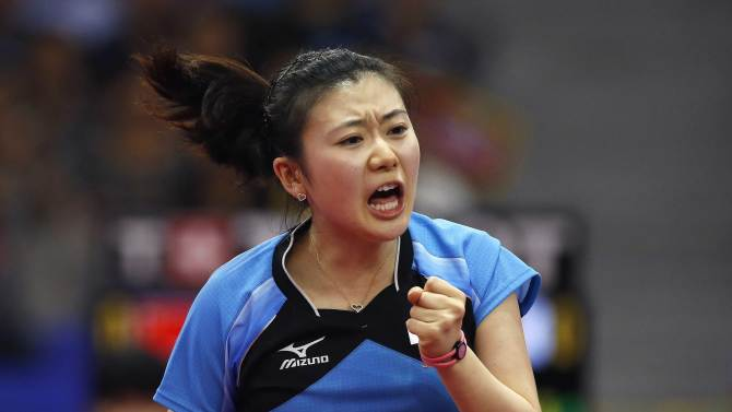 Japan's Ai Fukuhara reacts during her women's team gold medal table tennis match against China's Ding Ning at Suwon Gymnasium during the 2014 Asian Games in Incheon