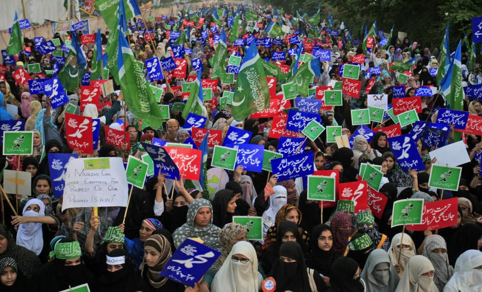 "Supporters of Pakistani religious party Jamaat-e-Islami, hold up placards during a rally against a film insulting the Prophet Muhammad, in Lahore, Pakistan, Sunday, Oct. 7, 2012. Most placards read, "" Muhammad, may God pray on him and grant him peace."" (AP Photo/K.M. Chaudary)"