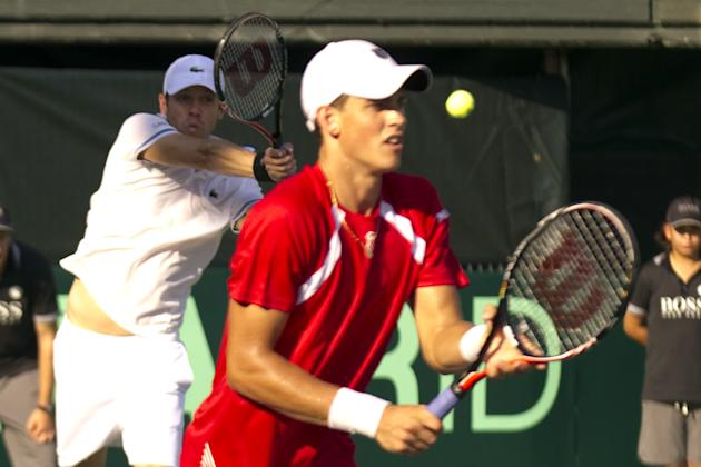 Canadian tennis player Daniel Nestor (L) and Vasek Pospisil (R) return to Israeli tennis team players Jonathan Erlich and Andy Ram during their Davis Cup world group doubles playoff tennis match in Ra