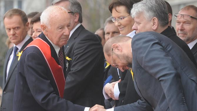 Simha Rotem, left, one of the last living Warsaw Ghetto insurgents,  shakes hands with President of the European Parliament Martin Schultz, during the revolt anniversary ceremonies in Warsaw, Poland, Friday, April 19, 2013. Sirens wailed and church bells tolled in Warsaw as largely Roman Catholic Poland paid homage Friday to the Jewish fighters who rose up 70 years ago against German Nazi forces in the Warsaw ghetto uprising. (AP Photo/Alik Keplicz)
