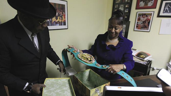 THIS CORRECTS TO STEWARD'S DAUGHTER, NOT SISTER - Emanuel Steward's daughter Sylvia Steward-Williams holds a championship belt created by the World Boxing Council (WBC) honoring Emanuel Steward at the trainer's office in Detroit, Tuesday, Nov. 13, 2012. A funeral service for the late boxing trainer was held Tuesday in Detroit. (AP Photo/Carlos Osorio)