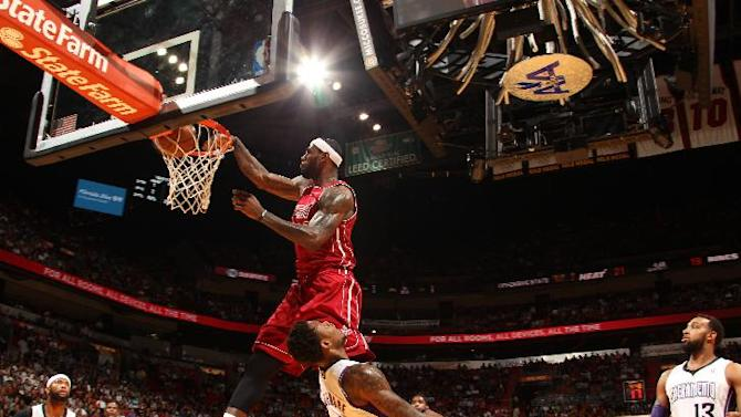 Heat stay hot, roll past Kings 122-103
