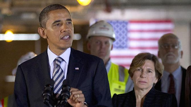 FILE - In this Dec. 2, 2011 file photo, President Barack Obama, accompanied by American Federation of Teachers President Randi Weingarten, gestures while speaking in a building under construction in Washington. Loose ends and thorny partisan tensions on education await the next Congress and President Barack Obama's second term. First up is the fiscal cliff, which will slash billions from the Department of Education's budget if lawmakers don't act this year.  (AP Photo/Carolyn Kaster, File)