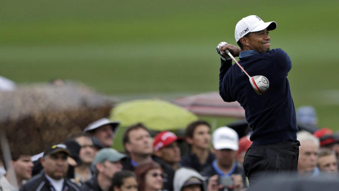 Tiger Woods hits his tee shot on the fourth hole of the north course at Torrey Pines during the second round of the Farmers Insurance Open golf tournament Friday, Jan. 25, 2013, in San Diego. (AP Photo/Gregory Bull)