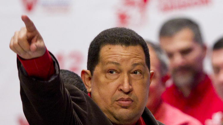 Venezuela's President Hugo Chavez gestures during an event at Teresa Carreno theater in Caracas, Venezuela, Thursday March 29, 2012.  Chavez returned home after a five-day round of radiation therapy in Cuba, where he has been undergoing cancer treatment. (AP Photo/Ariana Cubillos)
