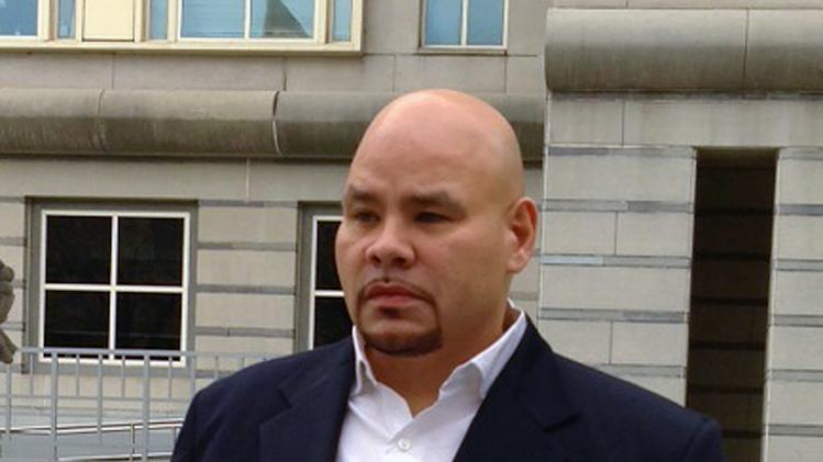 FILE - This Dec. 20, 2012 file photo shows rapper Fat Joe, whose real name is Joseph Cartagena, leaving court in Newark N.J. Cartagena is being sentenced sentenced Monday, June 24, in federal court after he pleaded guilty in December 2012 to failing to pay taxes on more than $1 million of income in 2007 and in 2008. The Miami Beach resident was prosecuted in New Jersey because some of the companies he earns money from are incorporated in Somerville. (AP Photo/Samantha Henry, file)