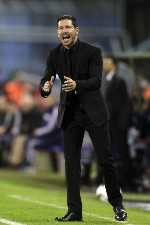 Atletico Madrid's coach Simeone reacts during their Spanish first division soccer match against Celta Vigo at the Balaidos stadium in Vigo
