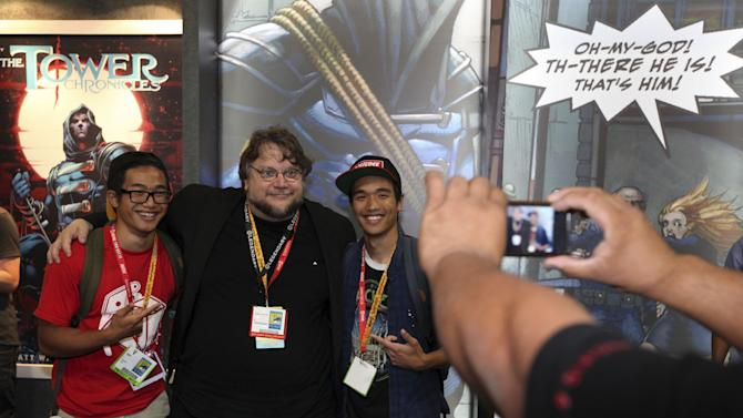 "COMMERCIAL IMAGE - A fan using an LG Electronics smart phone captures Guillermo Del Toro, director of the upcoming film ""Pacific Rim"", posing with fans during a signing at the Legendary booth at Comic-Con on Friday July 13, 2012, at the Convention Center in San Diego. (Photo by Jeff Bottari/Invision for LG Mobile Phones/AP Images)"