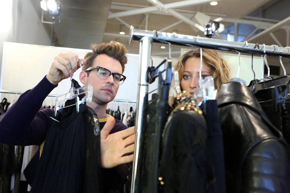 "This undated publicity image released by Bravo shows stylist Brad Goreski sorting through clothes in a scene from ""It's a Brad, Brad World,"" in Los Angeles, airing Wednesdays at 10 p.m. EST. (AP Photo/Bravo, Evans Vestal Ward)"