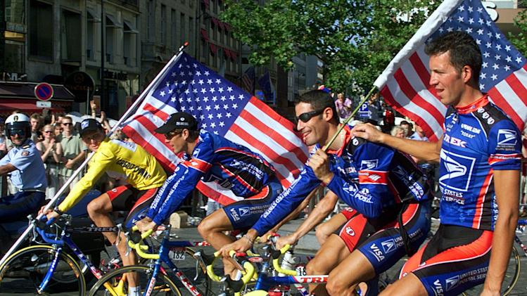 This July 25, 1999,  file photo shows Tour de France winner Lance Armstrong of the U.S. left, riding down the Champs Elysees avenue with teammates, from left,  Frankie Andreu,  of the U.S., George Hincapie of the U.S., and Pascal Derame, of France,  after the 20th and final stage of the Tour de France cycling race, in Paris. Armstrong, the superstar cyclist, whose stirring victories after his comeback from cancer helped him transcend sports, chose not to pursue arbitration in the drug case brought against him by the U.S. Anti-Doping Agency. That was his last option in his bitter fight with USADA and his decision set the stage for the titles to be stripped and his name to be all but wiped from the record books of the sport he once ruled.  (AP Photo/Laurent Rebours, File)