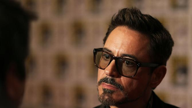 "Robert Downey Jr. attends the press line for ""Iron Man 3"" during Comic-Con, Saturday, July 14, 2012, in San Diego. (Photo by Matt Sayles/Invision/AP)"