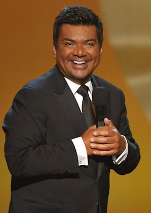 "FILE - In this Sept. 16, 2012 file photo, comedian George Lopez hosts the ALMA Awards in Pasadena, Calif. Amid rumors of another ""Tonight"" show shakeup, Lopez says he has no desire to return to the late-night talk show scene. Lopez said he had a great two-year run as a late night talk show host. But, he said, ""I'm out of that thing."" (Photo by John Shearer/Invision/AP, File)"