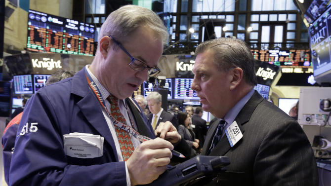 Traders David O'Day, left, and Mathias Roberts work on the floor of the New York Stock Exchange, Friday, Feb. 1, 2013. The Dow Jones industrial average briefly topped 14,000 on Friday morning, a milestone not seen since before the financial crisis rocked the markets and the world economy. Evidence that the U.S. economic recovery is firmly on track drove markets higher on Friday, adding to the cheer from good economic indicators out of Europe. (AP Photo/Richard Drew)