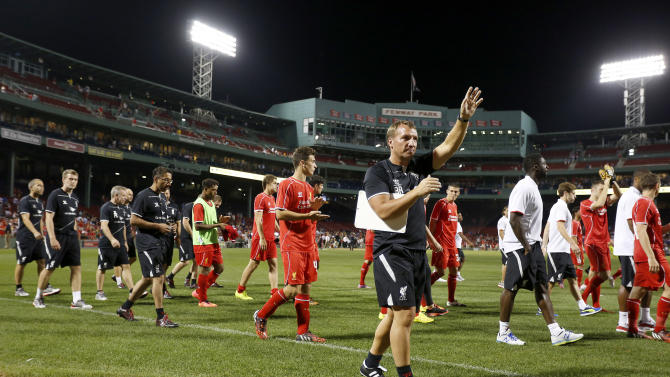 Liverpool manager Brendan Rodgers walks his team around the pitch after being defeated in a friendly soccer match between against Roma on July 23, 2014, in Boston, Massachusetts