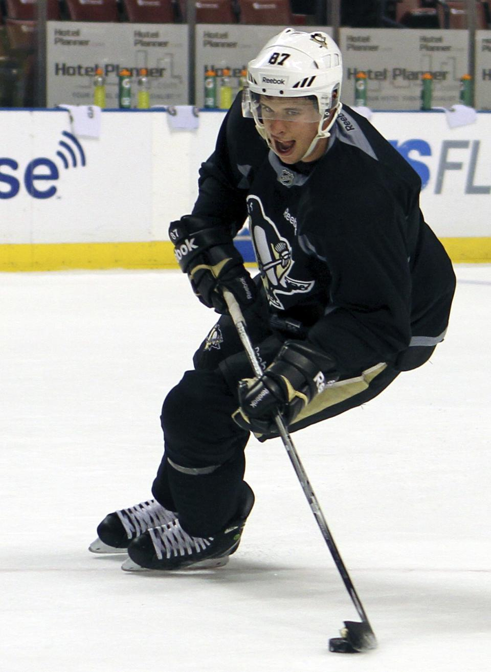 Pittsburgh Penguins star Sidney Crosby skates during practice in Sunrise, Fla., Friday, Jan. 13, 2012. Crosby skated with his teammates for the first time in more than a month on Friday but still has no idea when he'll be cleared to practice, let alone see action in a game.   (AP Photo/Alan Diaz)