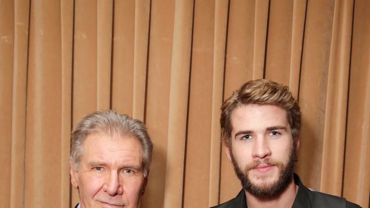 "Harrison Ford, cast member in the upcoming film ""Ender's Game"" and Liam Hemsworth, cast member in the upcoming film ""The Hunger Games: Catching Fire"" at Lionsgate Presentation at 2013 CinemaCon, on Thursday, April, 18th, 2013 in Las Vegas. (Photo by Eric Charbonneau/Invision for Lionsgate/AP Images)"