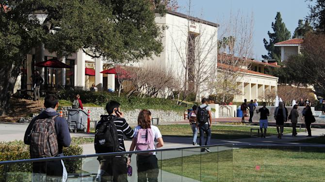 "In this Thursday, Feb. 2, 2012 photo, students walk through the campus of Claremont McKenna College in Claremont, Calif. When US News & World Report debuted its list of ""America's Best Colleges"" nearly 30 years ago, the magazine hoped its college rankings would be a game-changer for students and families. Arguably, they've had a much bigger effect on colleges themselves. A senior administrator at Claremont McKenna, a highly regarded California liberal arts college, resigned after acknowledging he falsified college entrance exam scores for years to rankings publications such as US News. The scale was small: submitting scores just 10 or 20 points higher on the 1600-point SAT math and reading exams. (AP Photo/Reed Saxon)"