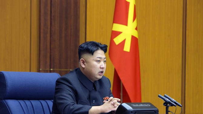 "In this undated photo released by the Korean Central News Agency and distributed Sunday, Feb. 3, 2013 in Tokyo by the Korea News Service, North Korean leader Kim Jong Un attends an enlarged meeting of the Central Military Commission of the Workers' Party of Korea at an undisclosed location of North Korea. Kim issued ""important"" guidelines on how to bolster the army and protect the nation's sovereignty at the high-level ruling Workers' Party meeting, state media said Sunday, an indication Pyongyang has finalized formal procedural steps and is ready to conduct an atomic test. (AP Photo/Korean Central News Agency via Korea News Service) JAPAN OUT UNTIL 14 DAYS AFTER THE DAY OF TRANSMISSION"