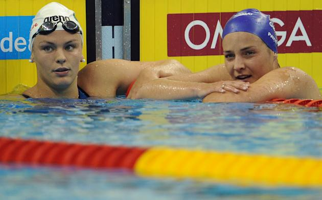 Ireland's Grainne Murphy (L) and Britain's Keri-Anne Payne talk after they competed in the heats of the women's 1,500-metre freestyle swimming event in the FINA World Championships at the