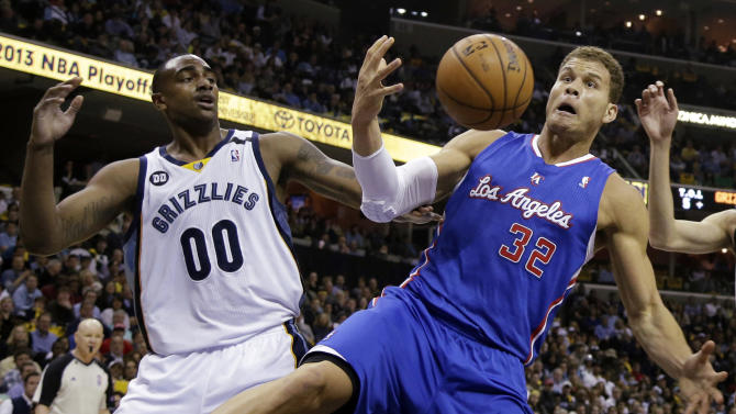 Los Angeles Clippers' Blake Griffin (32) reaches for a rebound in front of Memphis Grizzlies' Darrell Arthur (00) during the first half of Game 6 in a first-round NBA basketball playoff series in Memphis, Tenn., Friday, May 3, 2013. (AP Photo/Danny Johnston)