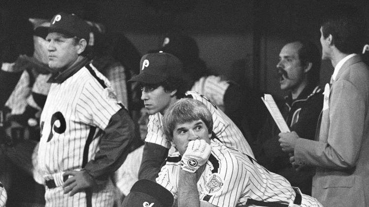 FILE - In this Oct. 14, 1983, file photo, Philadelphia Phillies first baseman Pete Rose looks around from the steps of the dugout in the first inning of Game 3 of baseball's World Series against the Baltimore Orioles in Philadelphia. Philadelphia manager Paul Owens benched Rose for the game. Tony Perez, Rose's 41-year-old replacement, went 1 for 4, and the Orioles overcame a two-run deficit for a 3-2 win that gave them a Series lead en route to a five-game victory. (AP Photo/File)
