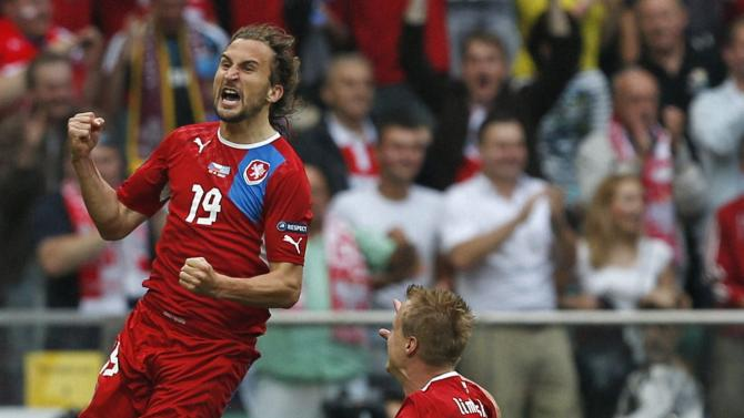 Wroclaw : Czech Republic's Petr Jiracek, left, celebrates after scoring a goal  during the Euro 2012 soccer championship Group A match between Greece and Czech Republic in Wroclaw, Poland, Tuesday, June 12, 2012. AP/PTI(AP6_12_2012_000215B)