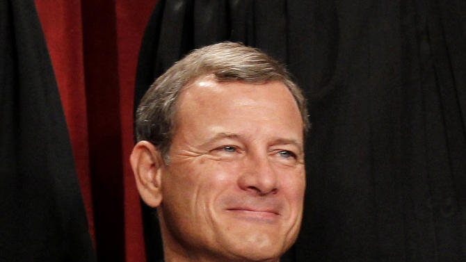 """FILE - In this Oct. 8, 2010 file photo, Chief Justice John Roberts is seen during the group portrait at the Supreme Court Building in Washington. Breaking with the court's other conservative justices, Roberts announced the judgment that allows the law to go forward with its aim of covering more than 30 million uninsured Americans. Roberts explained at length the court's view of the mandate as a valid exercise of Congress' authority to """"lay and collect taxes."""" The administration estimates that roughly 4 million people will pay the penalty rather than buy insurance.  (AP Photo/Pablo Martinez Monsivais, File)"""