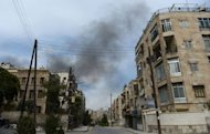 Smoke billows after government forces fired rockets and tank shells in the northern city of Aleppo