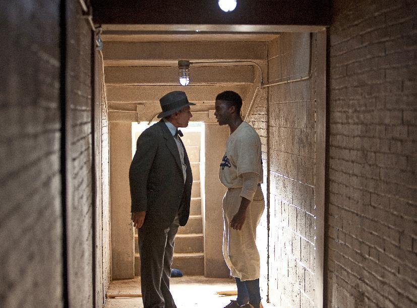 "This film image released by Warner Bros. Pictures shows Chadwick Boseman as Jackie Robinson, right, and Harrison Ford as Branch Rickey in a scene from ""42."" (AP Photo/Warner Bros. Pictures, D. Stevens)"