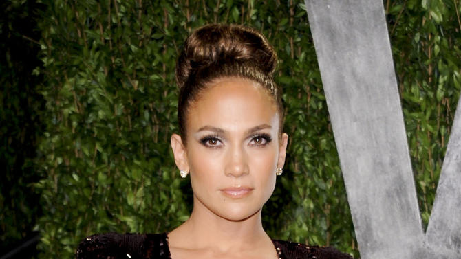 "FILE - In this Feb. 26, 2012 file photo, actress and singer Jennifer Lopez arrives at the Vanity Fair Oscar party in West Hollywood, Calif.  ABC Family announced Thursday, Aug. 23, 2012 that it has greenlighted a pilot titled ""The Fosters,"" from Jennifer Lopez's production company about a diverse family headed by a lesbian couple. (AP Photo/Evan Agostini, file)"