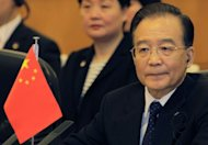China's Premier Wen Jiabao has vowed proactive policies to make growth a bigger priority, as the world's second largest economy showed signs of weakness, state press said