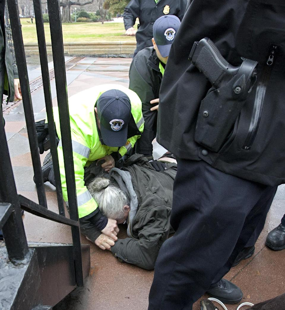 "Capitol Police arrest William Griffin as ""occupy Congress"" protesters are moved out of a restricted area on the West Lawn on Capitol Hill in Washington, Tuesday, Jan. 17, 2012.  (AP Photo/J. Scott Applewhite)"