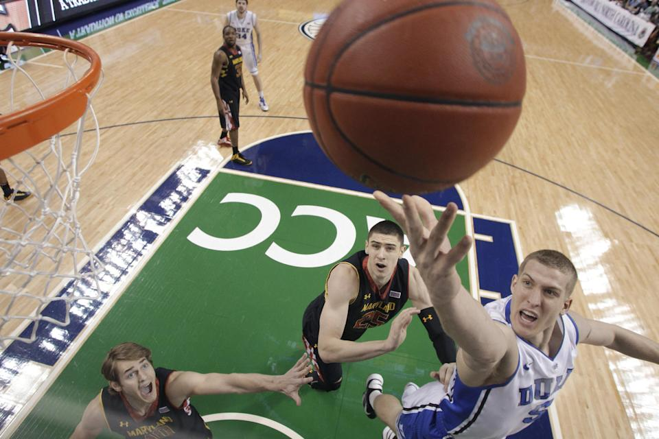 Duke's Mason Plumlee (5) shoots over Maryland's Alex Len (25) and Jake Layman (10) during the first half of an NCAA college basketball game at the Atlantic Coast Conference men's tournament in Greensboro, N.C., Friday, March 15, 2013. (AP Photo/Bob Leverone)