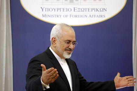 Iranian Foreign Minister Zarif gestures after a joint news conference with his Greek counterpart Kotzias in Athens