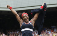 In this Saturday, Aug. 4, 2012 photo, United States&#39; Serena Williams celebrates after defeating Maria Sharapova of Russia to win the women&#39;s singles gold medal match at the All England Lawn Tennis Club at Wimbledon, in London, at the 2012 Summer Olympics. (AP Photo/Victor R. Caivano)
