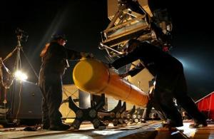 The Phoenix International AUV Artemis, also known as the Bluefin-21, is prepared for deployment from the Australian Defence Vessel Ocean Shield in the search for missing Malaysia Airlines Flight MH370, in Southern Indian Ocean