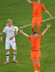 Dutch forward Klaas-Jan Huntelaar (R) gestures next to Danish defender Simon Kjær during their Euro 2012 football match