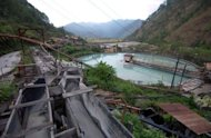 The mine tailing treatment pond operates at the fully legal ore milling plant of Philex Mining Corp., in Itogon, northern Benguet province, in 2006. Philippine authorities said Thursday they had seized a huge amount of iron ore intended to be smuggled to China, as part of a long-running battle against illegal miners
