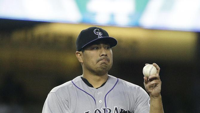 Colorado Rockies starting pitcher Jorge De La Rosa reacts after giving up a run during the fourth inning of a baseball game against the Los Angeles Dodgers, Friday, July 1, 2016, in Los Angeles. (AP Photo/Jae C. Hong)