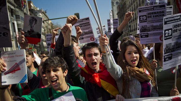 Demonstrators hold books and banners reading 'fight journey' as they shout slogans as part of a nationwide day of rallies called to protest against cuts in education spending as Spain endures austerity and the prospect of recession in Madrid, Wednesday, Feb. 29, 2012. (AP Photo/Daniel Ochoa de Olza)