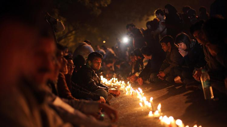Indians participate in a candle lit vigil as they mourn the death of a gang rape victim in New Delhi, India, Saturday, Dec. 29, 2012. Indian police charged six men with murder on Saturday, adding to accusations that they beat and gang-raped the woman on a New Delhi bus nearly two weeks ago in a case that shocked the country. The murder charges were laid after the woman died earlier Saturday in a Singapore hospital where she has been flown for treatment. (AP Photo/Altaf Qadri)