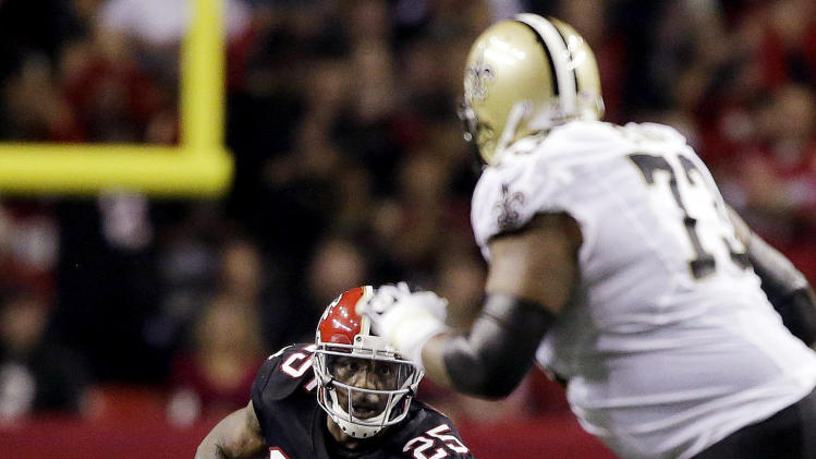 Atlanta Falcons strong safety William Moore (25) returns an interception during the second half of an NFL football game against the New Orleans Saints, Thursday, Nov. 29, 2012, in Atlanta. (AP Photo/David Goldman)