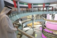 <p>An Emirati man stands in the Dubai Mall in the oil-rich Gulf emirate. Among new attractions in a mega development plan in Dubai is a mall touted to be the largest in the world, not far from what is already the world's largest shopping and entertainment destination, the Dubai Mall.</p>