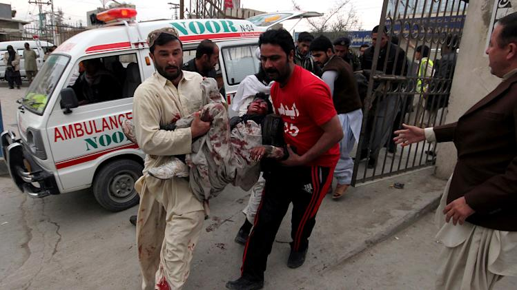Pakistani volunteers rush an injured victim from a bomb blast in a commercial area to a local hospital in Quetta, Pakistan, Thursday, Jan. 10, 2013. The bomb targeting paramilitary soldiers killed at least 12 people and wounded more than 40 others, according to a senior police official. A series of bombings in different parts of Pakistan killed 115 people on Thursday in one of the deadliest days in the country in recent years. (AP Photo/Arshad Butt)