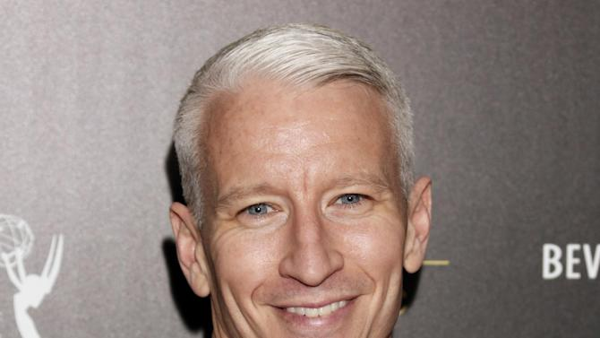"""FILE - This June 23, 2012 file photo shows CNN's Anderson Cooper as he arrives at the 39th Annual Daytime Emmy Awards at the Beverly Hilton Hotel in Beverly Hills, Calif.  Cooper's daytime talk show will be wrapping after two seasons. Warner Bros. said Monday, Oct. 29, 2012, that the marketplace made it increasingly difficult for """"Anderson Live"""" to """"break through"""" to viewers despite format changes. (Photo by Todd Williamson/Invision/AP, file)"""