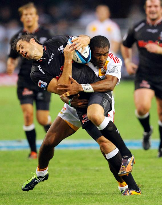 New Zealand Waikato Chiefs' Asaeli Tikoirotuma (R) tackles Sharks of Durban's Louis Ludik during the Super 15 rugby union match Sharks of Durban vs Waikato Chiefs of New Zealand at the Mr Price Kings