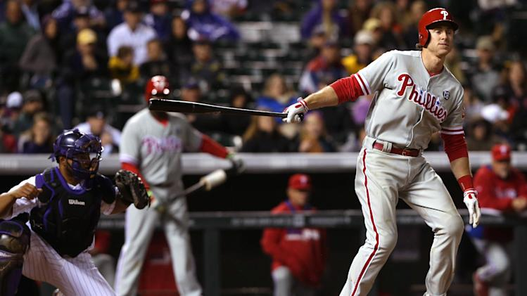 Philadelphia Phillies' Chase Utley, right, strikes out swinging as Colorado Rockies catcher Wilin Rosario fields the pitch to close out the top of the eighth inning of the Rockies' 3-1 victory in a baseball game in Denver on Saturday, April 19, 2014