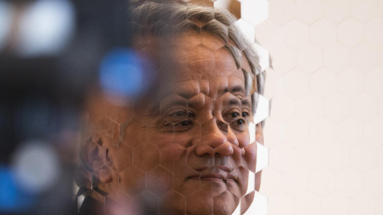 Indian Artist Anish Kapoor is mirrored  as he stands in front of  his sculpture 'Hexagon Mirror'  at the  exhibition 'Kapoor In Berlin' in  the Martin-Gropius-Bau museum in Berlin, Friday, May 17, 2013. The exhibition will run from May 18, until Nov. 24, 2013. (AP Photo/Markus Schreiber)
