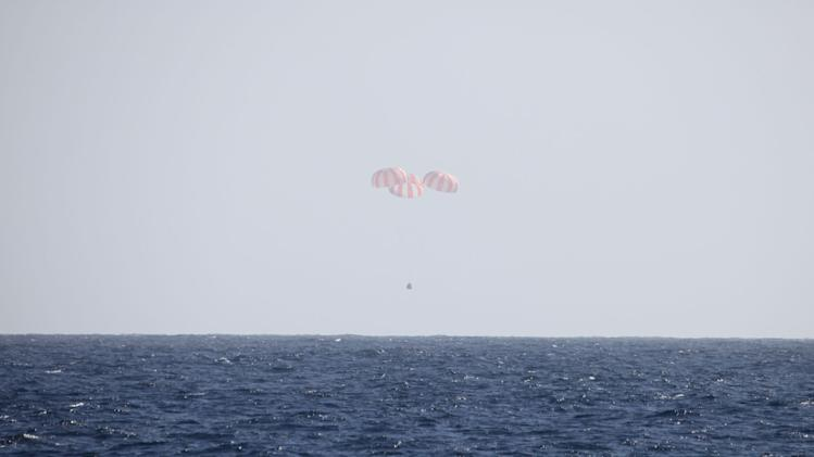 In this image provided by SpaceX, the Dragon capsule uses parachutes to descend to the Pacific Ocean off the coast of Mexico's Baja Peninsula after leaving the International Space Station. The vehicle brought back more than 1 ton of science experiments and old station equipment. It's the only supply ship capable of two-way delivery. NASA is paying SpaceX more than $1 billion for a dozen resupply missions. (AP Photo/SpaceX)